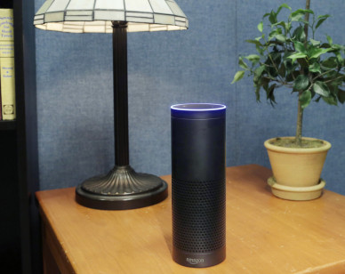 FILE - In this July 29, 2015, file photo, an Amazon Echo sits on a table in New York. The gadget, which listens to you, answers questions and carries out tasks like calling an Uber or turning on your lights, is finding a place in millions of living rooms. However, it will soon face competition from Google and Apple. (AP Photo/Mark Lennihan, File)