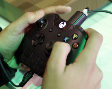 PARIS, FRANCE - OCTOBER 25:  A gamer uses a Xbox video game controller to play the video game 'Fifa 19' developed and published by Electronic Arts during the 'Paris Games Week' on October 25, 2018 in Paris, France. 'Paris Games Week' is an international trade fair for video games and runs from October 26 to 31, 2018.  (Photo by Chesnot/Getty Images)