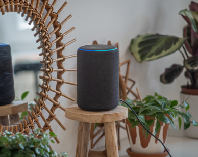 VIENNA,AUSTRIA - April 4 : Amazon Alexa Echo Plus on a wooden table with green plants in the background